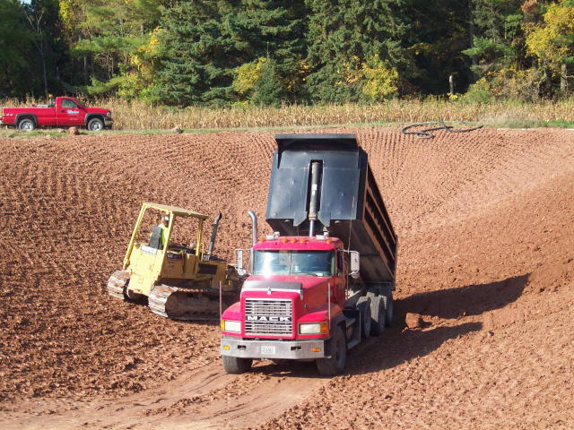 Manitowoc area excavator and tiling company pond construction